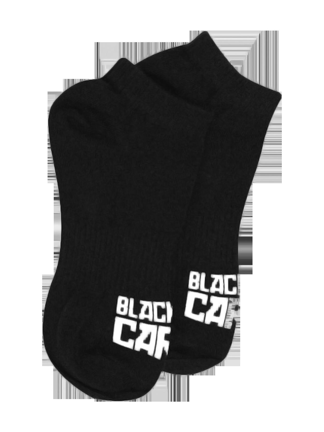 Носки унисекс CartelНоски унисекс из коллекции Black Star Wear. Однотонная модель с контрастной надписью Black Star Cartel на тыльной стороне стопы и заниженным верхом, облегающим щиколотку. Изделие из хлопка с добавлением эластичных волокон для лучшей и более плотной посадки по ноге. Прекрасно подходят для повседневной носки и занятий спортом.<br><br>Размер: 39/40<br>Цвет: Черный<br>Пол: Унисекс