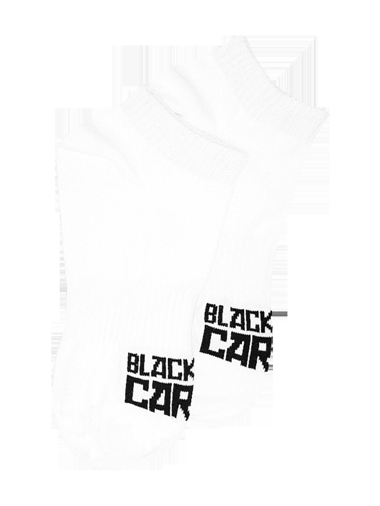 Носки унисекс CartelНоски унисекс из коллекции Black Star Wear. Однотонная модель с контрастной надписью Black Star Cartel на тыльной стороне стопы и заниженным верхом, облегающим щиколотку. Изделие из хлопка с добавлением эластичных волокон для лучшей и более плотной посадки по ноге. Прекрасно подходят для повседневной носки и занятий спортом.<br><br>Размер: 41/42<br>Цвет: Белый<br>Пол: Унисекс